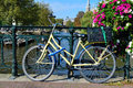 Amsterdam canal bicycle on bridge Royalty Free Stock Photo