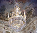 Beautiful ancient crystal chandelier antique against a ceiling with frescoes and stucco at nymphenburg palace in munich bavaria Stock Images