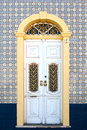 Beautiful antique door in a decorated facade white Stock Images