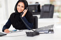 Beautiful arabian office worker talking phone Royalty Free Stock Image