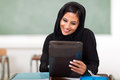 Beautiful arabian teenage girl using tablet computer classroom Royalty Free Stock Image