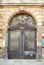 Beautiful art nouveau door gate with ugly graffiti Royalty Free Stock Photo