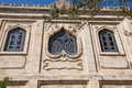 Beautiful artistic details of the old church at crete island greece unique in style romanticism facade st titos in heraklion Stock Photography
