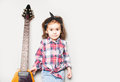 Beautiful artistic little girl playing guitar on grey background. Place for your text