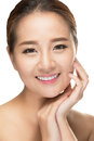 Beautiful asian beauty woman touching perfect skin face laughing happy healthy skincare concept smiling girl smiling at camera Stock Photo