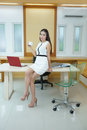 Beautiful asian business woman standing at her desk in office Stock Images