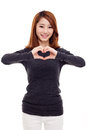 Beautiful Asian casual woman show heart shape. Stock Images