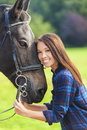 Beautiful Asian Eurasian Girl With Her Horse Royalty Free Stock Photo