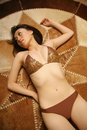 Beautiful Asian girl in a bikini Royalty Free Stock Photo