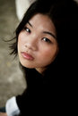 Beautiful asian girl in black wearing a jacket looking at viewer Stock Image