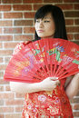 Beautiful Asian girl with a fan Royalty Free Stock Images