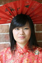 Beautiful Asian girl with a fan Stock Photography
