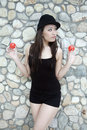 Beautiful Asian girl holding two balls Stock Images