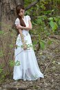 Beautiful Asian girl leaned against the tree Royalty Free Stock Photo