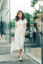 Beautiful asian girl with shopping bags standing outside the mal Royalty Free Stock Photo