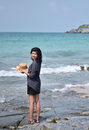 Beautiful asian girl smiling at the beach si chang island thailand Royalty Free Stock Image