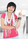 Beautiful asian girl smiling and pointing at the room Royalty Free Stock Photos