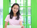 Beautiful asian girl smiling and using laptop computer Stock Photo