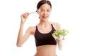 Beautiful Asian healthy girl enjoy eating  salad Royalty Free Stock Photo
