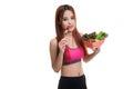 Beautiful Asian healthy girl enjoy eating  salad. Royalty Free Stock Photo
