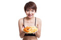 Beautiful Asian healthy girl with french fries and  fired chicke Royalty Free Stock Photo