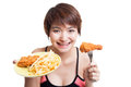 Beautiful Asian healthy girl with french fries and fired chicken Royalty Free Stock Photo