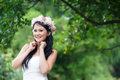Beautiful asian lady white bride dress posing in the forest greenery background model is thai ethnicity Royalty Free Stock Photography
