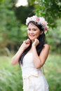 Beautiful asian lady white bride dress posing in the forest greenery background model is thai ethnicity Stock Images