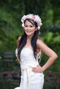 Beautiful asian lady white bride dress posing in the forest greenery background model is thai ethnicity Royalty Free Stock Photo