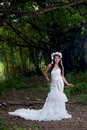 Beautiful asian lady white bride dress posing in the forest greenery background model is thai ethnicity Stock Image