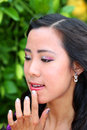 Beautiful asian school age girl high fixing lipstick Royalty Free Stock Photography