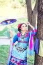 Beautiful asian woman in colorful dress