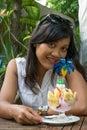 Beautiful asian woman eating desert Royalty Free Stock Photo
