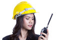 Beautiful asian woman engineer holding a radio Stock Photography