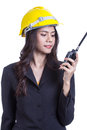 Beautiful asian woman engineer holding a radio Royalty Free Stock Image