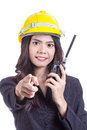 Beautiful asian woman engineer holding a radio Royalty Free Stock Photo