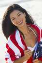 Beautiful asian woman girl in american flag on beach young chinese laughing wearing bikini and wrapped towel a sunny Royalty Free Stock Photography