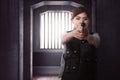 Beautiful asian woman with gun standing alone Royalty Free Stock Photo