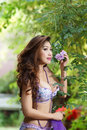 Beautiful asian woman in lingerie voluptuous posing outdoors Royalty Free Stock Images