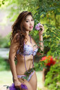 Beautiful asian woman in lingerie voluptuous posing outdoors Stock Images