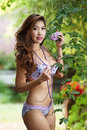 Beautiful asian woman in lingerie voluptuous posing outdoors Royalty Free Stock Photography