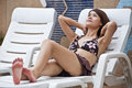 Beautiful asian woman on poolside chair portrait Royalty Free Stock Images