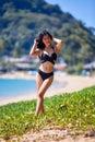 Beautiful asian woman posing on a tropical beach Royalty Free Stock Photo