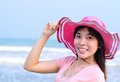 Beautiful asian woman relaxation on beach with hat Royalty Free Stock Photo