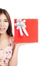 Beautiful asian woman show red gift box on her palm hand isolated white background Stock Images