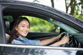 Beautiful Asian woman smiling and enjoying.driving a car on road Royalty Free Stock Photo