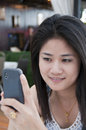 Beautiful Asian woman using mobile phone. Stock Photos
