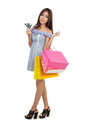 Beautiful asian woman walking with shopping bags show credit car cards on white background Stock Photos