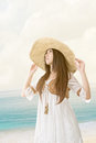 Beautiful asian young woman with seascape backgrou outdoor portrait of a wearing knitted hat at the beach background Stock Images