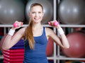 Beautiful athlete woman working out with dumbbells Stock Photography